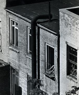 Woman on Fire Escape, 1962 Gelatin silver print, printed c. 1962. 4 15/16 x 3 3/4 inches