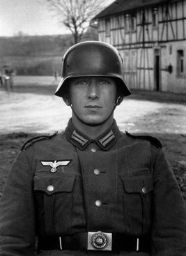 August Sander Soldier, c. 1940     Gelatin silver print mounted to board, printed c. 1990.  10 1/4 x 7 1/2 in.