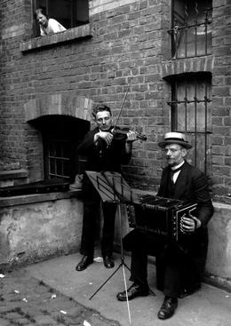 August Sander Street Musicians, 1922-1928     Gelatin silver print mounted to board, printed c. 1990. 10 1/4 x 7 1/4 in.