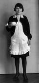 August Sander Café Waitress, 1928-1929     Gelatin silver print mounted to board, printed c. 1990.  10 1/4 x 5 in.