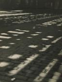 Sun Patterns on Cobblestones, New York City, 1921 Gelatin silver print, printed c. 1921 9 1/2 x 7 1/2 inches