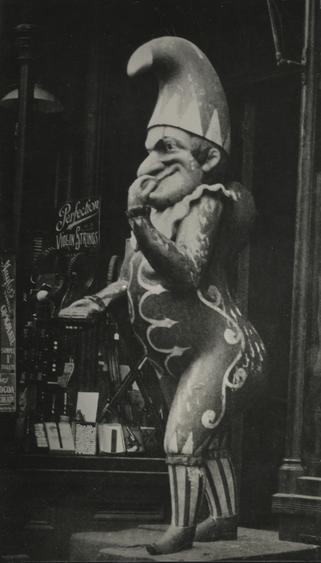 Wooden Joker Outside Tobacco Shop, New York City, 1926 Gelatin silver print, printed c. 1926 6 1/2 x 3 3/4 inches