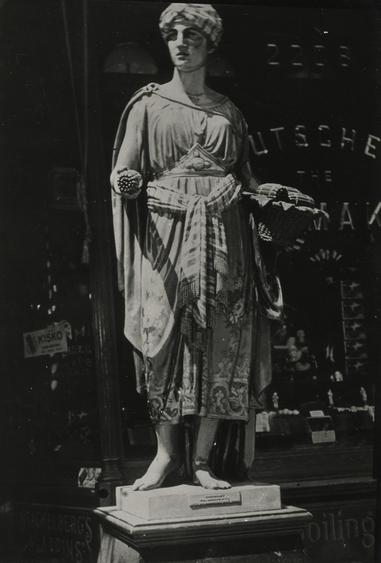 Wooden Figure Outside Tobacco Shop, New York City, 1926 Gelatin silver print, printed c. 1926 6 x 4 inches
