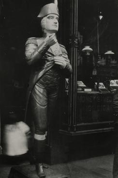 Wooden Figure Outside Tobacco Shop, New York City, 1926 Gelatin silver print, printed c. 1926 6 x 4 1/4 inches