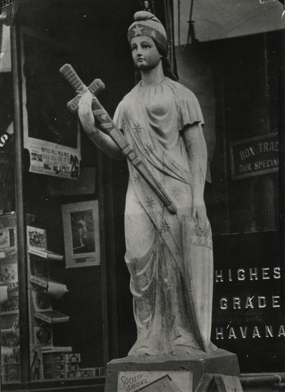 Wooden Figure Outside Tobacco Shop, New York City, 1926 Gelatin silver print, printed c. 1926 6 x 4 1/2 inches
