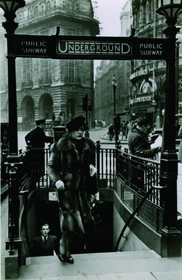 Woman Exiting Piccadilly Underground Station, London, c. 1939 Gelatin silver print, printed c. 1939 6x 3 3/4 inches