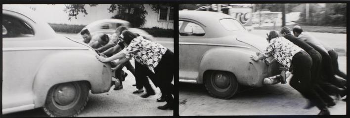 Pushing, Houston, 1971 Gelatin silver print mounted to board, printed c. 1971 4 5/8 x 13 3/8 inches