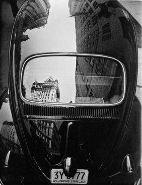 Volkswagen Reflection, New York City, 1962 Gelatin silver print, printed c. 1962 14 x 11 inches