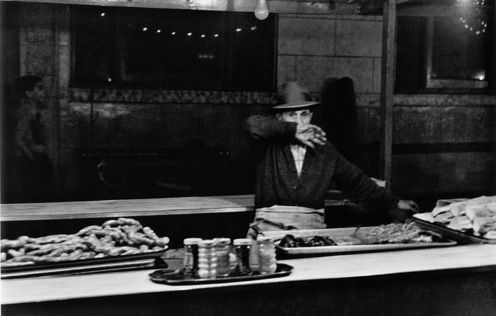 Man Behind Food Counter, San Gennaro Festival, New York City, 1959 Gelatin silver print, printed c. 1959 11 x 14 inches