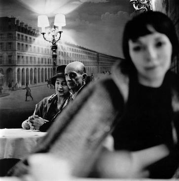 Old Couple and Young Woman at Cafe, Paris, France, 1961 Gelatin silver print, printed later 14 x 11 inches