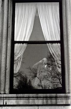 Man in Window Saluting, New York City, 1956 Gelatin silver exhibition print mounted to board, printed c. 1956 13 1/2 x 10 1/2 inches