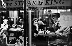 Couple in Cafe Window, Times Square, New York City, 1956 Gelatin silver print mounted to board, printed c. later 11 x 14 inches