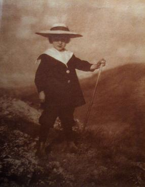 Young Boy with Hat and Walking Stick, c. 1900-1910 Toned pigment print mounted to tissue, printed c. 1900-1910 14 1/4 x 11 inches
