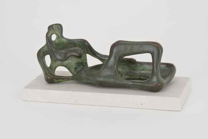 Henry Moore(1898-1986) Reclining Figure, 1945 Bronze with green and brown patina 7 1/2 in. (19.1 cm)