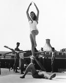Woman Being Balanced, Muscle Beach, Santa Monica, CA, 1954 Gelatin silver print, printed later 14 1/4 x 11 1/4 in. (36.2 x 28.6 cm) Signed on verso $3,000 Inquire