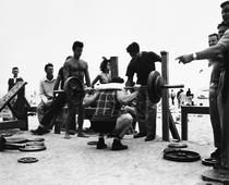 A Body Builder in a Squatting Position, Muscle Beach, Santa Monica, CA, 1954 Gelatin silver print, printed later 12 7/8 x 15 1/2 in. (32.7 x 39.4 cm) Signed on verso $3,500 Inquire