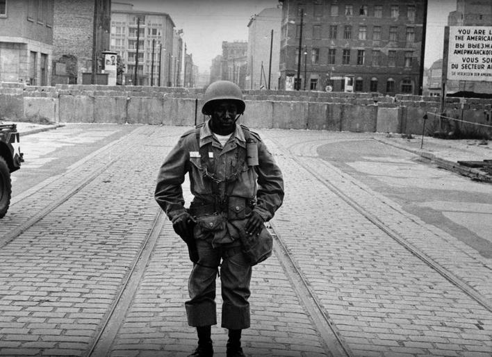 Black in White America, American Soldier In Front of the Berlin Wall, 1963 Gelatin silver print, printed c.1963 10 1/2 x 14 inches