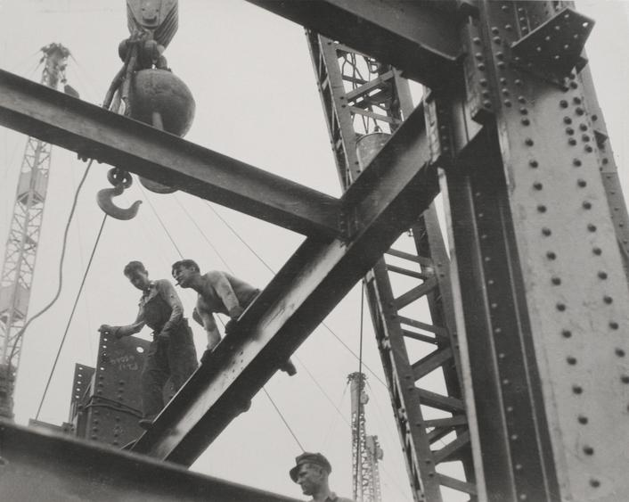 The 'Steel Workers' are Always on Top. 'Constructors' Lay a Beam. Empire State', c. 1930 Gelatin silver print, printed c. 1930 7 1/2 x 9 1/2 inches