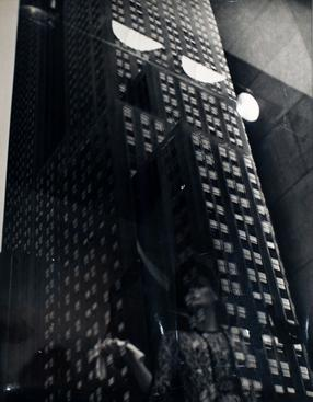 ​Lisette Model Fifth Avenue, New York (Reflections), 1939-1945 Gelatin silver print, printed c. 1939-1945. 13 3/4 x 11 inches