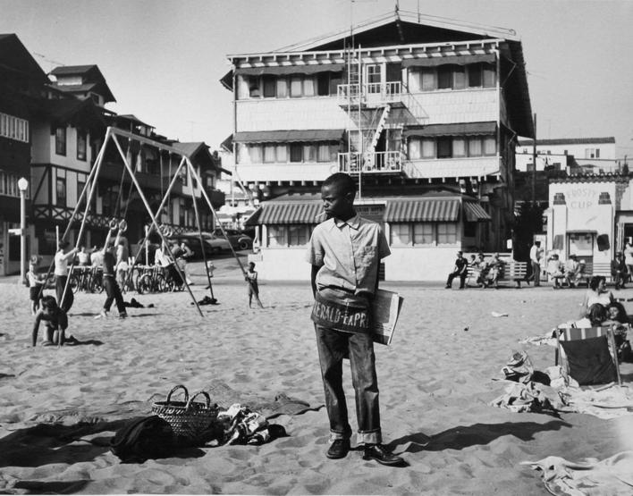 Newsboy, Muscle Beach, Santa Monica, 1954 Gelatin silver print, printed later 11 x 14 inches