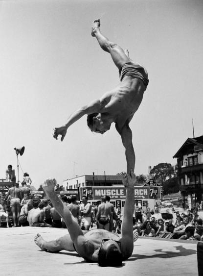 Two Men Doing a Handstand, Muscle Beach, Santa Monica, 1954 Gelatin silver print, printed later 14 x 11 inches