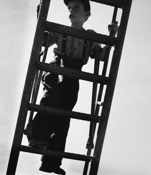 Boy With Crutches Climbing Ladder, 1950 Gelatin silver print, printed later 14 x 17 inches