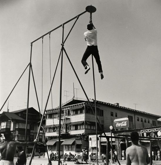 Shinning, Muscle Beach, Santa Monica, CA, 1954 Gelatin silver print, printed 1985 16 x 20 in. (40.6 x 50.8 cm) Signed, titled, dated with artist stamp on verso Sold