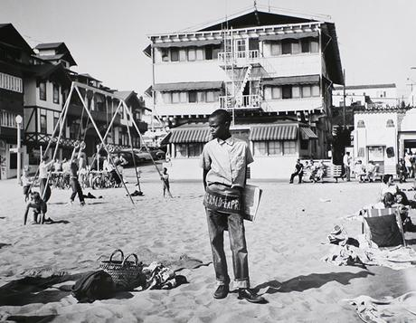Newsboy, Muscle Beach, Santa Monica, CA, 1954 Gelatin silver print, printed later 16 x 20 in. (40.6 x 50.8 cm) Signed, dated, annotated, and titled on verso Sold