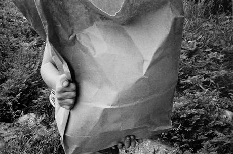 Boy Behind Big Bag, 1974 Gelatin silver print, printed 1974. 16 x 20 inches