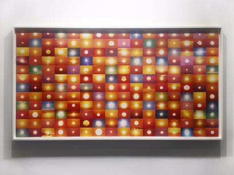 Installation view: Suns (From Sunsets) from Flickr, 2006-ongoing 48 x 96 inches