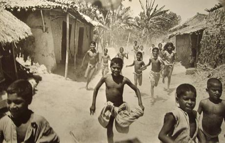 Bihar, India (Famine in India, Food arrives at a village), 1951 Gelatin silver exhibition print mounted to masonite 30 x 46 1/2 inches