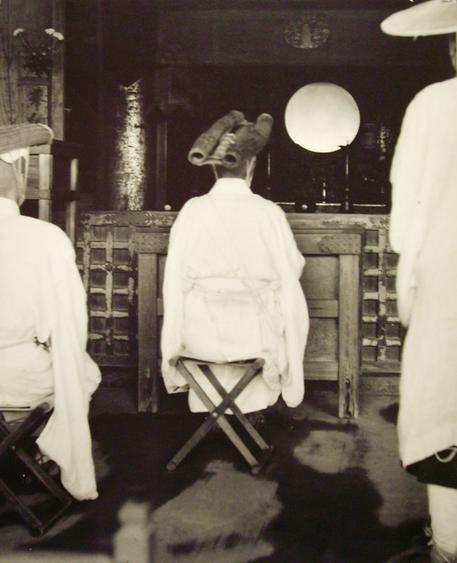 Pilgrim before the Altar of Kyomizu Temple, Japan, 1951 Gelatin silver exhibition print mounted to masonite 29 7/8 x 24 inches